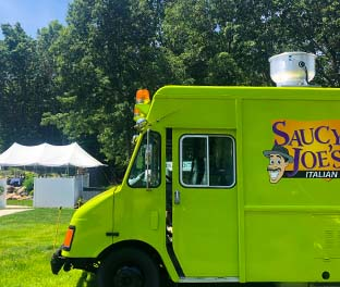 Saucy Joe's Food Truck parked in backyard at private party